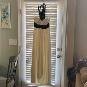 Long cream prom dress with black neck accent!